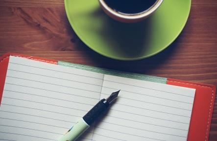 coffee-notebook-wooden-background-162588.jpeg